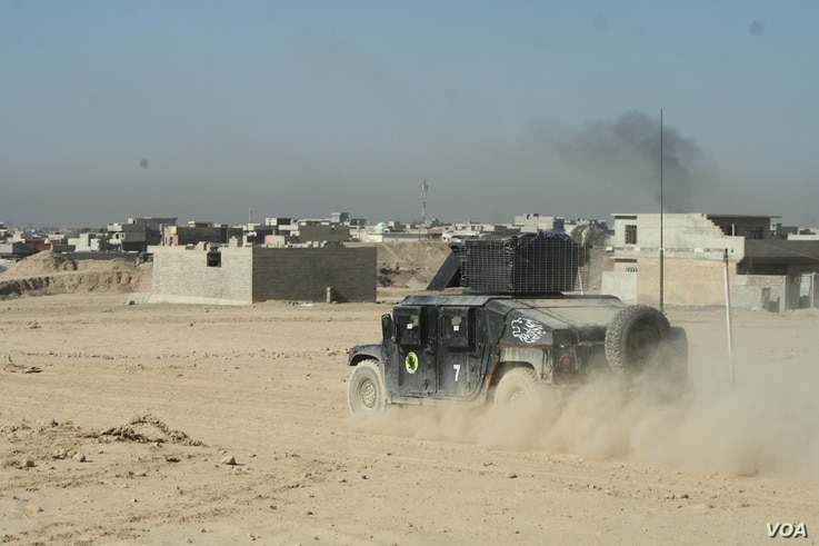 An Iraqi Army vehicle races to the front in Mosul, Iraq, Nov. 19, 2016.
