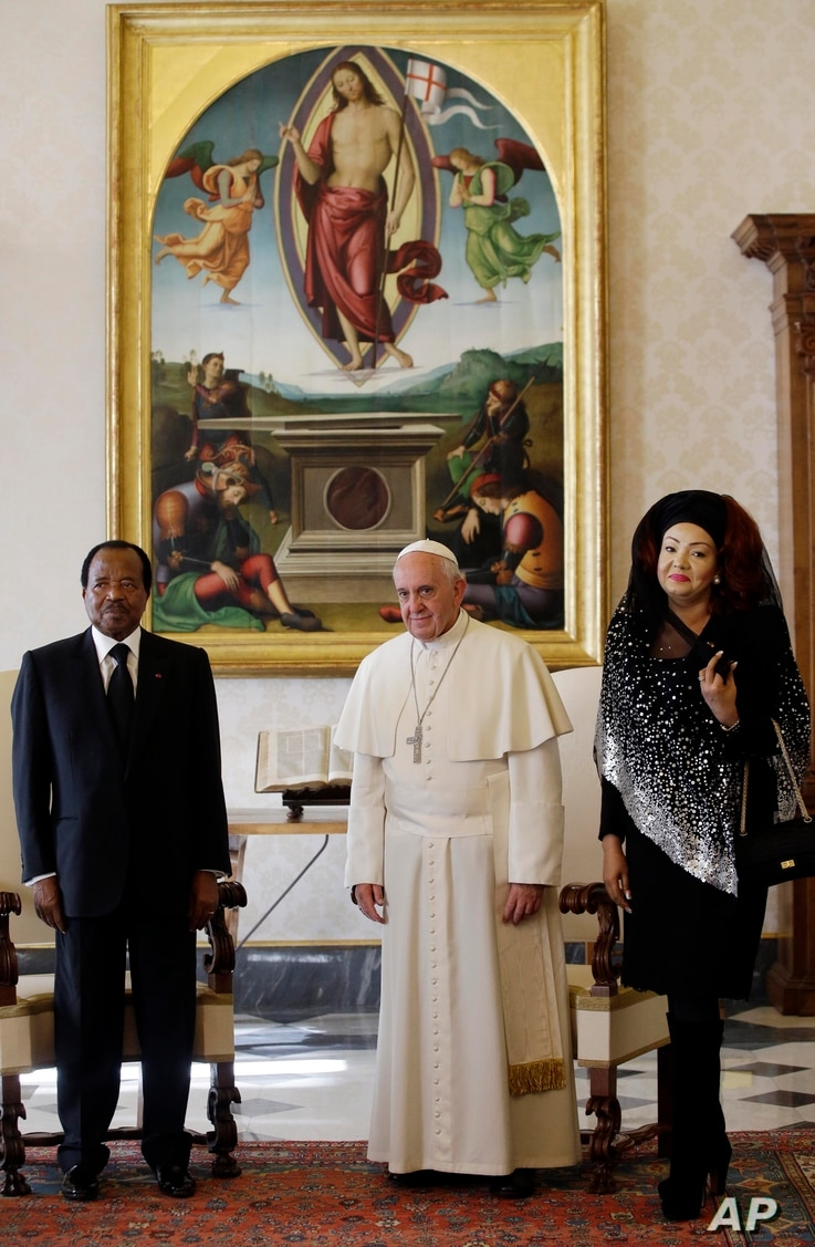 FILE - Pope Francis poses with Cameroon President Paul Biya and his wife Chantal Biya during a private audience at the Vatican, Oct. 18, 2013.