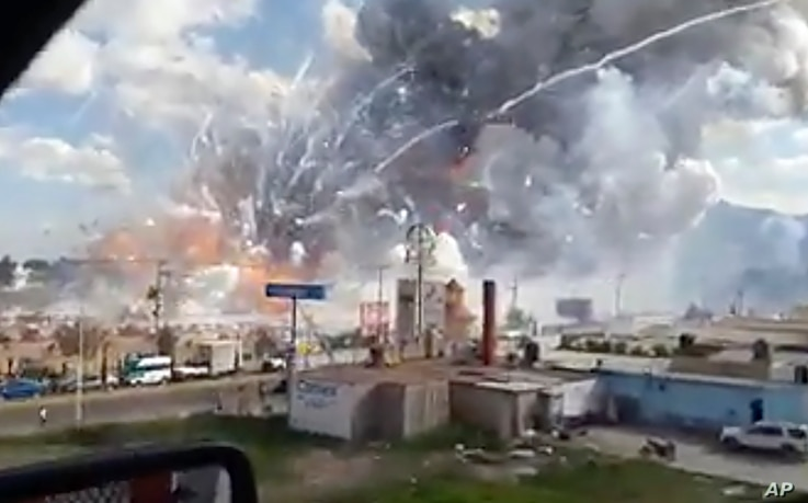 This image made from video shows an explosion ripping through the San Pablito fireworks' market in Tultepec, Mexico, Dec. 20, 2016.