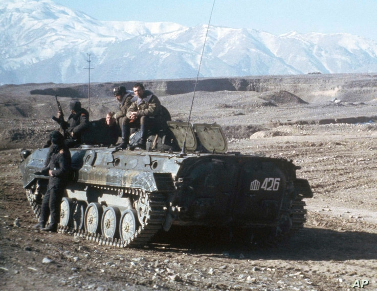 Soviet heavy armor is shown on the snowy foothills in Afghanistan at a small encampment near Kabul, Jan. 7, 1980, after elements of the Soviet armed forces made their controversial entry into Afghanistan territory.