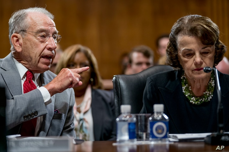 Senate Judiciary Committee Chairman Chuck Grassley, R-Iowa (L), accompanied by Sen. Dianne Feinstein, D-Calif., the ranking member (R), speaks during a Senate Judiciary Committee markup meeting on Capitol Hill, Sept. 13, 2018, in Washington.