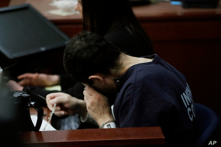 Dr. Larry Nassar wipes his face after a gymnast gave her victim impact statement during the seventh day of his sentencing hearing, Jan. 24, 2018, in Lansing, Mich.
