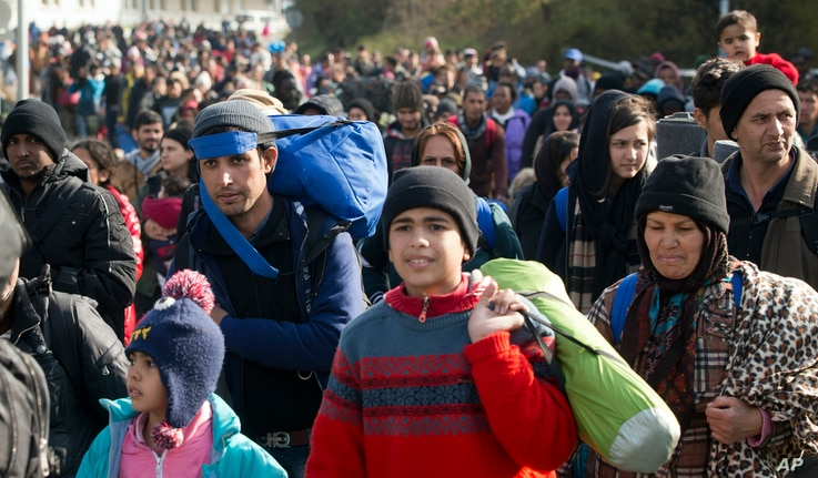 Migrants are seen walking towards Austria in Sentilj, Slovenia, Oct. 30, 2015. Asylum-seekers hoping to reach Western Europe turned to crossing Slovenia after Hungary closed its border with Croatia with a barbed-wire fence.