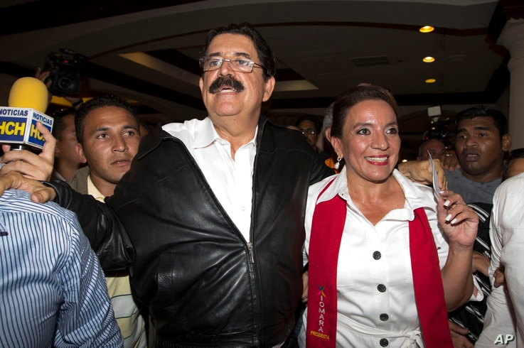 Free Party presidential candidate Xiomara Castro, right, and her husband, ousted President Manuel Zelaya, leave after giving a press conference before partial election results were announced in Tegucigalpa, Honduras, Sunday, Nov. 24, 2013.