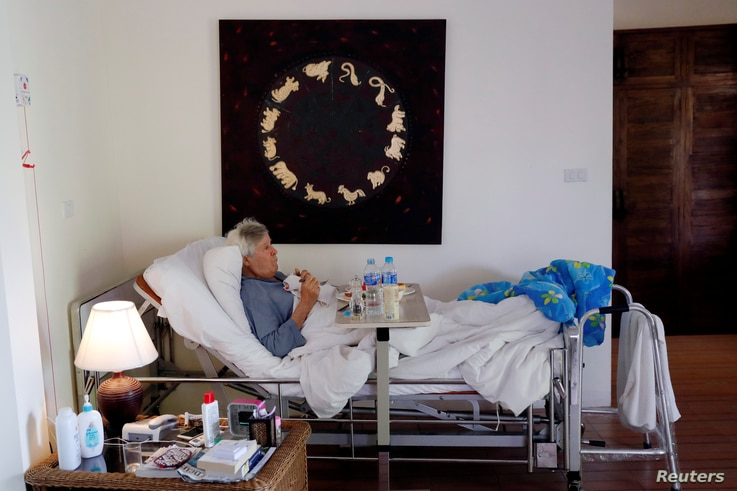 Charles, a retiree from England has breakfast in bed, while staying at the Care Resort in Chiang Mai, Thailand April 6, 2018. Picture taken April 6, 2018.