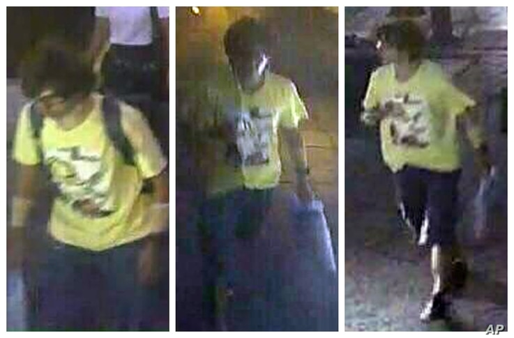This Aug. 17, 2015, image, released by Royal Thai Police spokesman Lt. Gen. Prawut Thavornsiri shows a man wearing a yellow T-shirt near the Erawan Shrine before an explosion occurred in Bangkok, Thailand.