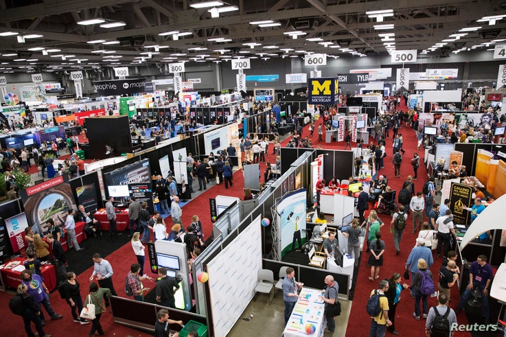 Visitors attend the 2015 Trade Show at the South by Southwest (SXSW) interactive, film and music conference in Austin, Texas, March 15, 2015.