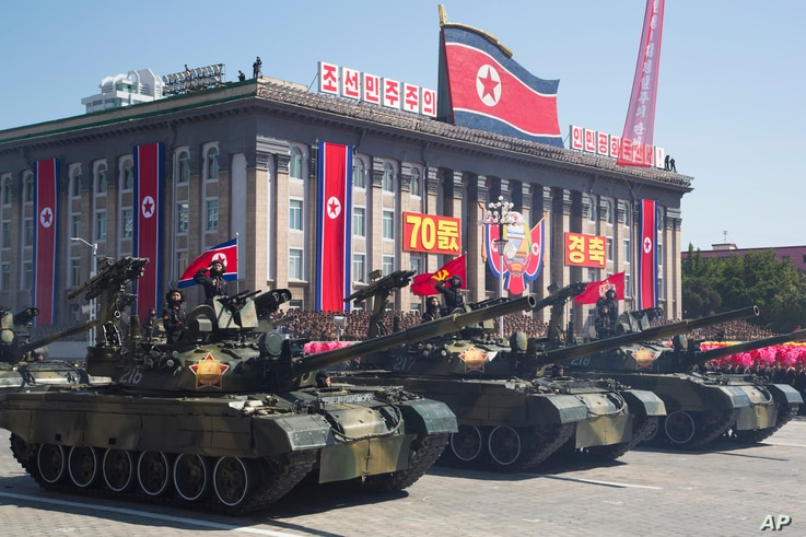North Korean tanks roll past during a parade for the 70th anniversary of North Korea's founding day in Pyongyang, North Korea, Sept. 9, 2018.
