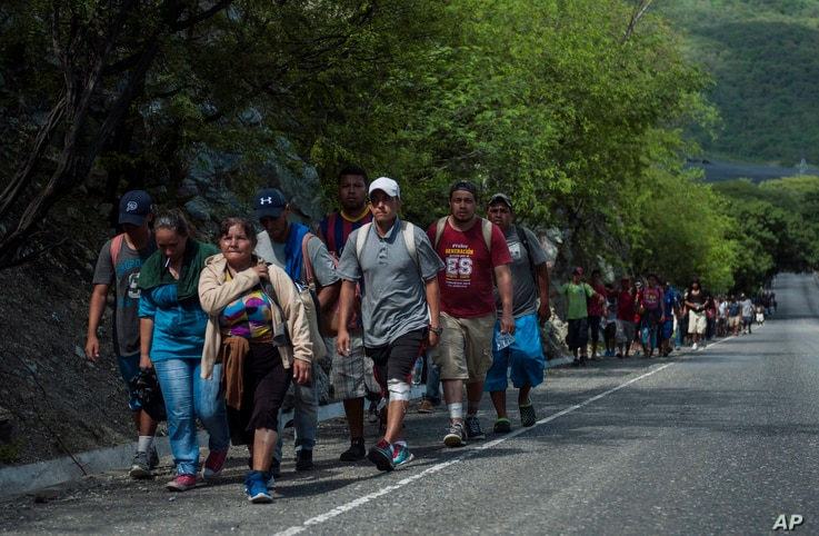 Honduras migrants walk to the U.S as they approach Zacapa, about 70 miles northeast of Guatemala City, Oct. 24, 2018.