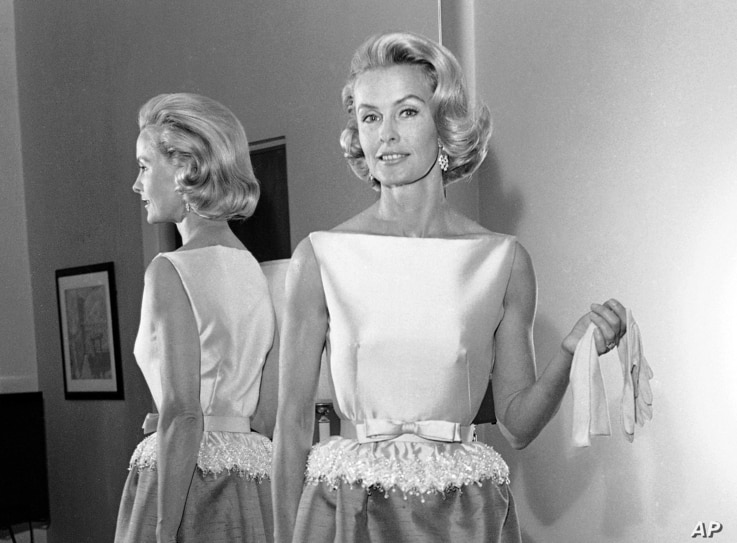 FILE - In this April 6, 1962, photo, socialite-actress Dina Merrill models the gown she was to wear at the Academy Awards presentation in Los Angeles. Merrill, the rebellious heiress who defied her super-rich parents to become an actress, died May 22...