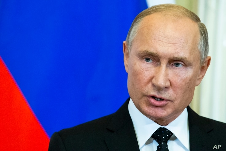 Russian President Vladimir Putin speaks to the media during a joint news conference with Hungarian Prime Minister Viktor Orban after their talks in the Kremlin in Moscow, Sept. 18, 2018.