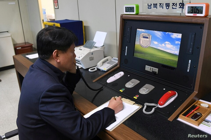 A South Korean government official checks the direct communications hotline to talk with the North Korean side at the border village of Panmunjom, Jan. 3, 2018.