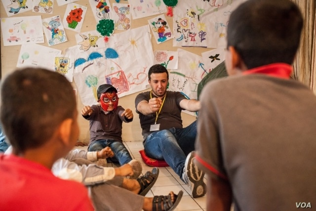 The International Rescue Committee organizes psycho-social activities for children who have been settled in overcrowded urban areas, without access to safe and secure places to play and express themselves. (Photo: courtesy Andrea Falcon/IRC)