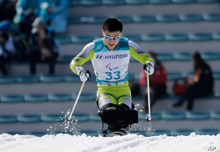 Kim Jong Hyon of North Korea competes in the qualification round, March 14, 2018, of the men's 1.1km sprint, sitting, cross-country skiing at the 2018 Winter Paralympics in Pyeongchang, South Korea.