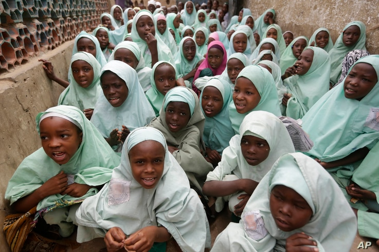 In this photo taken April. 6, 2016 Muslim girls wearing hijab attend lectures in a school in Kano, Nigeria.