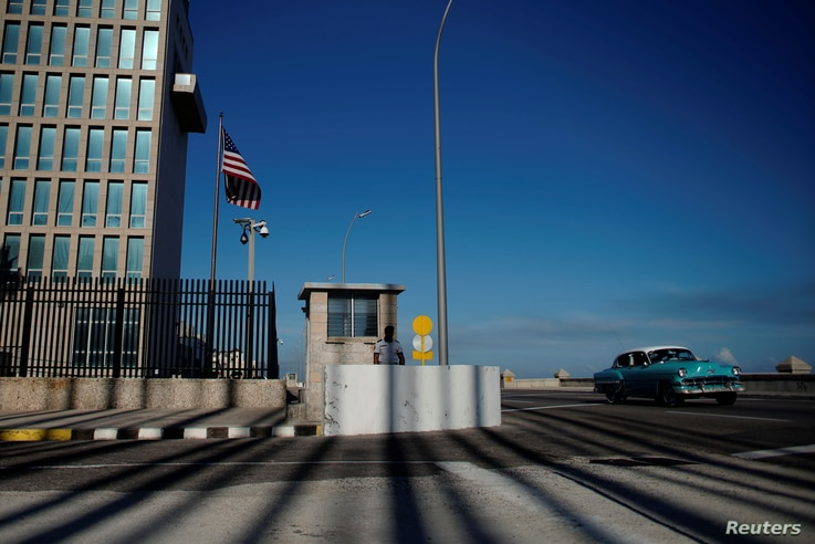 A vintage car passes by the U.S. embassy in Havana, Cuba, March 12, 2019.