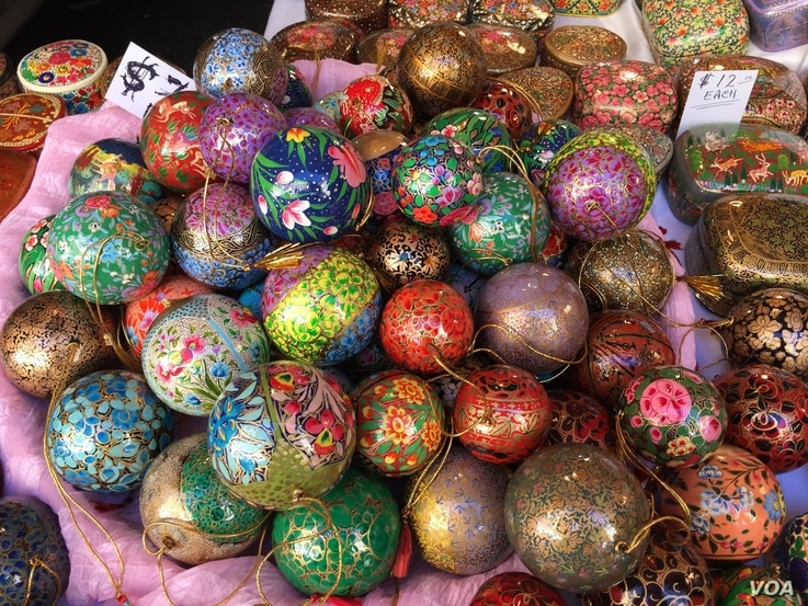 These hand painted ornaments from Kashmir, sold at the Downtown Holiday Market, are made of papier-mâché. (J.Taboh/VOA)