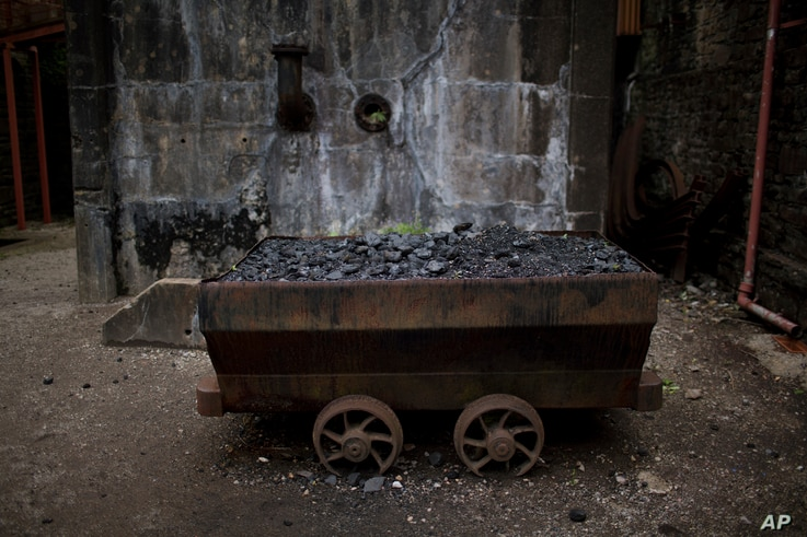 FILE - An old wagon filled with coal remains at the Rhondda Heritage Park, the former Lewis Menthyr Colliery in Pontypridd, Wales, June 30, 2016. Britain's last deep coal mine closed in 2015.