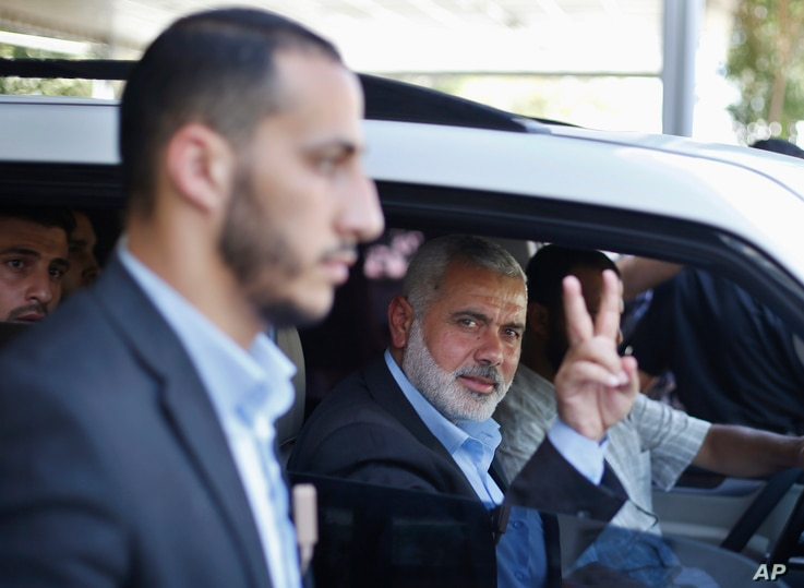 Senior Hamas leader Ismail Haniyeh gestures as leaves his office as a former Hamas government Prime Minister, in Gaza City June 2, 2014.