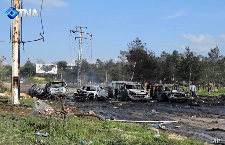 This image released by the Thiqa News Agency shows charred and damaged cars at the scene of an explosion in the Rashideen area, a rebel-controlled district outside Aleppo city, Syria, April. 15, 2017.