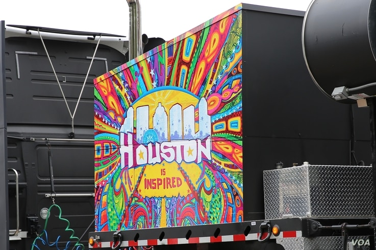 Food trucks are everywhere at the Super Bowl Live fan festival in downtown Houston, some sporting colorful murals and decorations. (B. Allen/VOA)