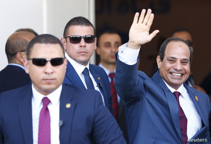 FILE - Egyptian President Abdel Fattah el-Sissi waves during the opening ceremony of the new Suez Canal, in Ismailia, Aug. 6, 2015. The former military leader is consolidating his control of the country, experts say.