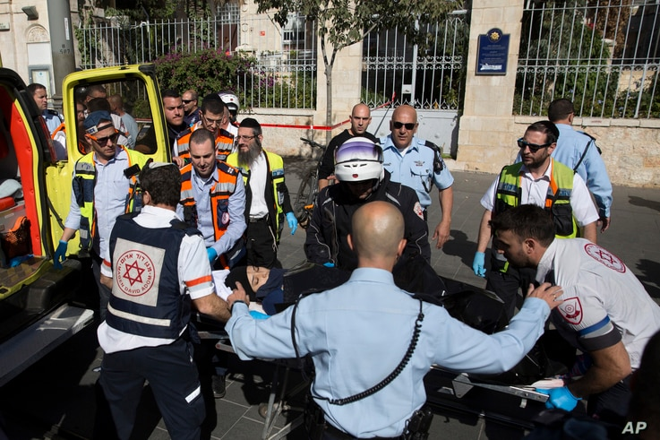 Israeli medics move a Palestinian woman, who police believe attacked a man, at the scene of a stabbing attack in Jerusalem, Nov. 23, 2015.