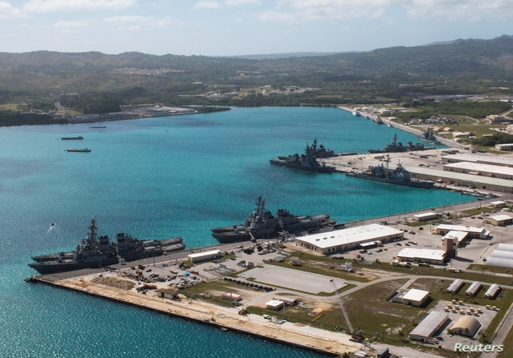 FILE - Navy vessels are moored in port at the U.S. Naval Base Guam at Apra Harbor, Guam, March 5, 2016.