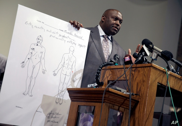 The Brown family's attorney Daryl Parks speaks during a news conference to share preliminary results of a second autopsy done on 18-year-old Michael Brown, in St. Louis County, Missouri, Aug. 18, 2014.