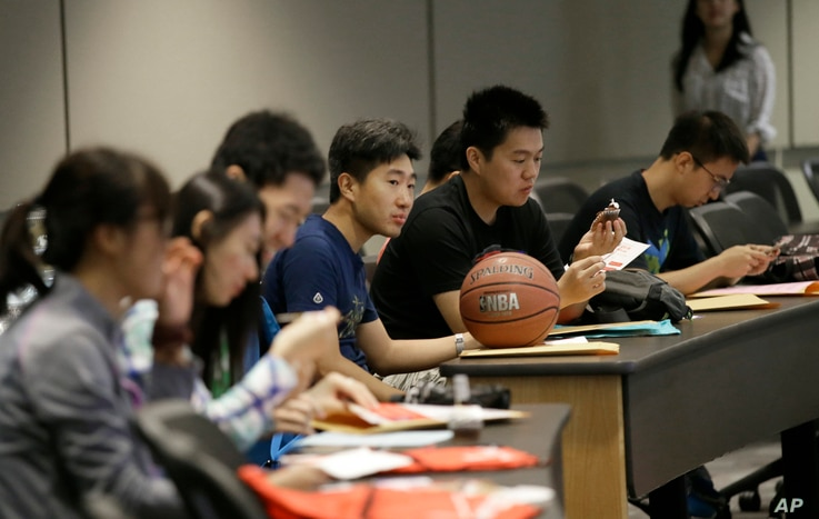 FILE - Students attend a new student orientation at the University of Texas at Dallas in Richardson, Texas, Aug. 22, 2015.