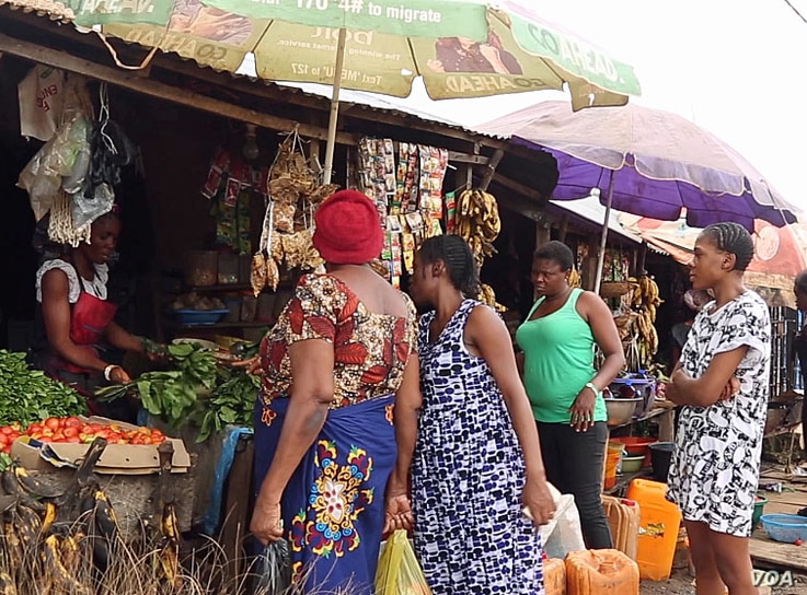 Women are shopping at a market in Abuja, Nigeria, in this screen grab taken from video.
