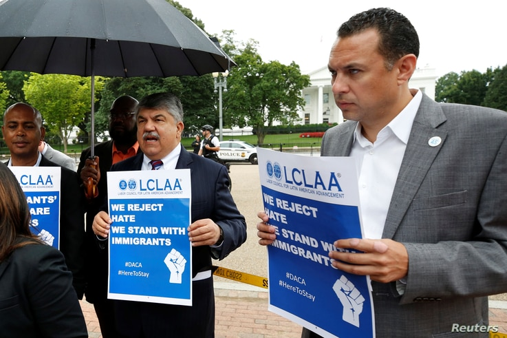 AFL-CIO President Richard Trumka, center, participates in a protest against President Donald Trump's decision to end DACA outside the White House in Washington, Sept. 6, 2017.