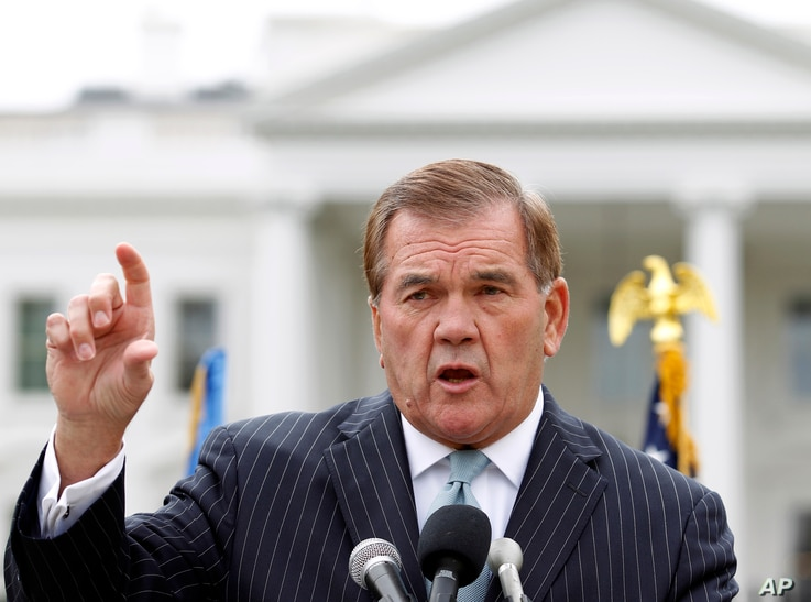 FILE -  former Secretary of Homeland Security Tom Ridge speaks to a crowd of hundreds protesting in front of the White House in Washington.