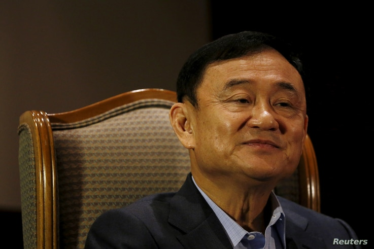 FILE - Former Thai Prime Minister Thaksin Shinawatra speaks to Reuters during an interview in Singapore, Feb. 23, 2016.