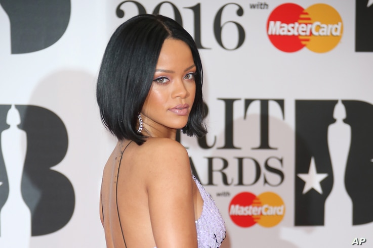 Singer Rihanna poses for photographers upon arrival for the Brit Awards 2016 at the 02 Arena in London, Feb. 24, 2016.