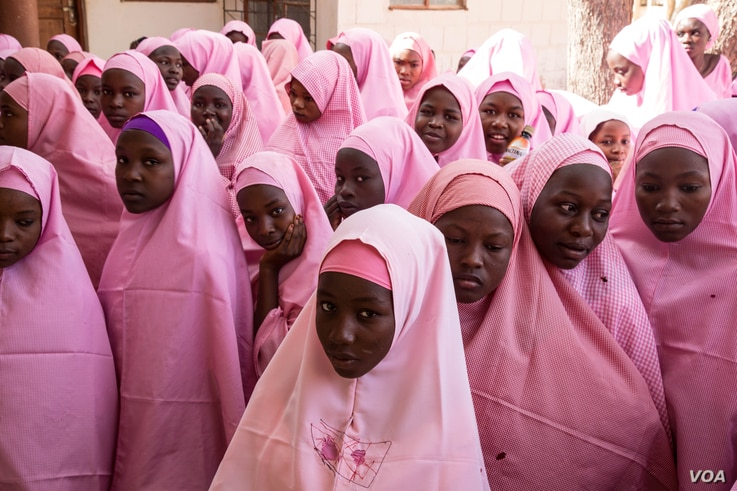 The Dapchi schoolgirls gather for morning assembly on the first day back to school after the February abduction.