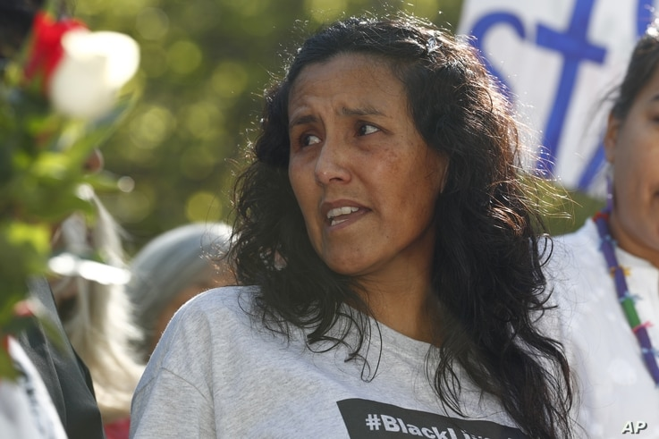 Jeanette Vizguerra, a Mexican immigrant who has lived in a church to avoid immigration authorities for the past three months, speaks after leaving the church, May 12, 2017, in downtown Denver. Vizguerra won a two-year deportation delay.