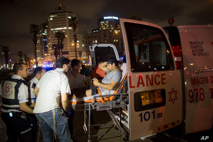 A wounded man is evacuated from the scene of a stabbing attack in Jaffa, a mixed Jewish-Arab part of Tel Aviv, Israel, March 8, 2016.