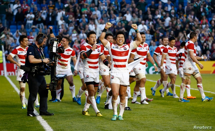 Japan celebrate victory after IRB Rugby World Cup 2015 Pool B match, Sept. 19, 2015.