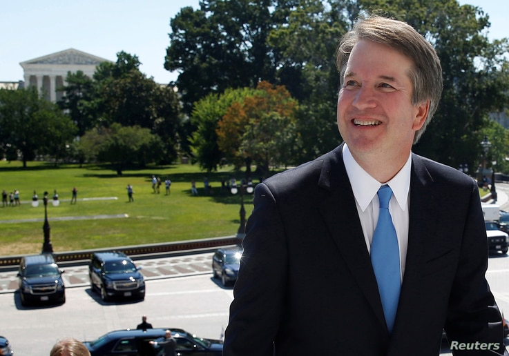 With the U.S. Supreme Court building in the background, Supreme Court nominee judge Brett Kavanaugh arrives prior to meeting with Senate Majority Leader Mitch McConnell on Capitol Hill in Washington, July 10, 2018.