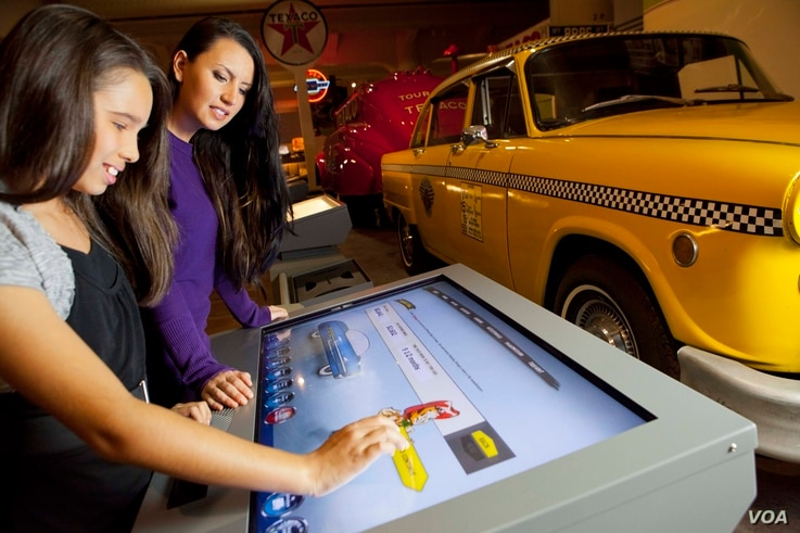 FILE - A touch-screen interactive inside the Driving America exhibit at The Henry Ford in Dearborn, Michigan.