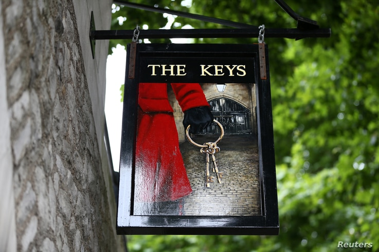 A pub sign of The Yeoman Warders Club at the Tower of London, July 20, 2017.