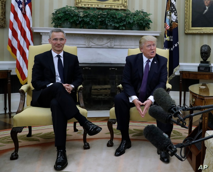 President Donald Trump (R) meets with NATO Secretary General Jens Stoltenberg in the Oval Office of the White House in Washington, April 12, 2017.