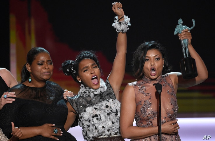 "Octavia Spencer, from left, Janelle Monae, Taraji P. Henson, and Kirsten Dunst accept the award for outstanding performance by a cast in a motion picture for ""Hidden Figures"" at the 23rd annual Screen Actors Guild Awards, Jan. 29, 2017, in Los Angele"