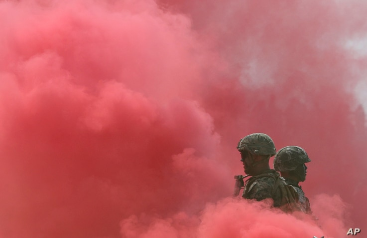 South Korea and U.S. Marines stand in smoke during the 66th Incheon Landing Operations Commemoration ceremony in Incheon, South Korea, Sept. 9, 2016.