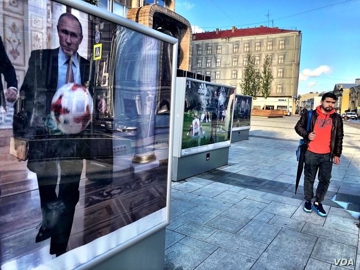 An image of Vladimir Putin playing soccer in the Kremlin adorns a downtown Moscow street. Securing mega-sporting events like the World Cup and the 2014 Winter Olympics have helped the Russian president craft his image as the leader of a country risin...