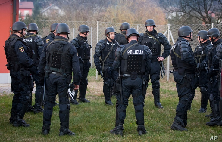 Slovenian police gather near the Croatian border in Rigonce, Slovenia, as the country beefs up security to control the migrant tide, Nov. 11, 2015.