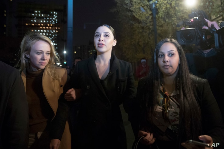 "Emma Coronel, center, the wife of Joaquin Guzman, leaves Brooklyn Federal Court after opening arguments in the trial of the Mexican drug lord known as ""El Chapo,"" Nov. 13, 2018, in New York."