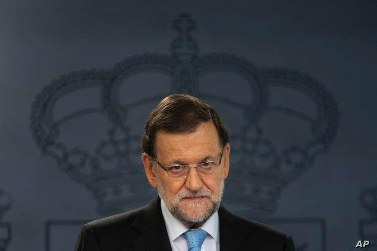 Spain's Prime Minister Mariano Rajoy listens to a question during a news conference at the Moncloa Palace, the premier's official resident, in Madrid, Nov. 11, 2015.