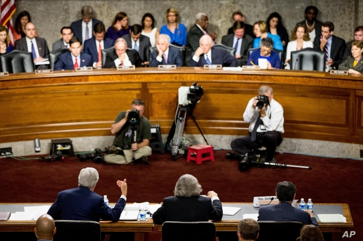 From left, Secretary of State John Kerry, Secretary of Energy Ernest Moniz and Secretary of Treasury Jack Lew testify at a Senate Foreign Relations Committee hearing to review the Iran nuclear agreement, in Washington, July 23, 2015.